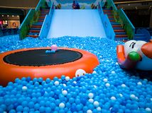 Bubble pool for kids with toys. Blue bubble pool for kids, child and children. play inside like swiming in the sea for fun. execise to improve the baby action. a Stock Image