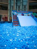 Bubble pool for kids with toys. Blue bubble pool for kids, child and children. play inside like swiming in the sea for fun. execise to improve the baby action. a Stock Images