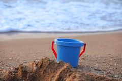 Blue Bucket on beach Royalty Free Stock Photos