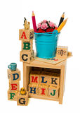 Blue bucket with color pencil on wooden alphabet block box Stock Image