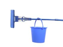 Blue bucket on mop with sponge. Royalty Free Stock Photo