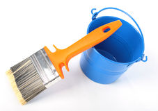 Blue bucket and new orange brush. Stock Photos