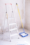 Blue bucket with paint, brush roller paint tray and ladder Royalty Free Stock Images