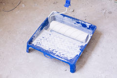 Blue bucket with paint and a brush roller paint tray Stock Image