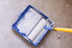 Blue bucket with paint and a brush roller paint tray Stock Photos