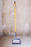 Blue bucket with paint and a brush roller paint tray Royalty Free Stock Photos