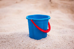 Blue bucket with red handle Royalty Free Stock Photos