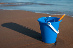 Blue Bucket on Sandy Beach Royalty Free Stock Photos