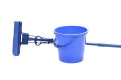 Blue bucket with sponge mop. Stock Photos