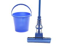 Blue bucket with sponge mop. Royalty Free Stock Photography