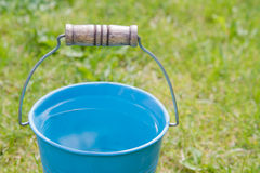 Blue bucket of water Stock Photo