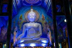 Blue Buddha statue inside Temple Wat Rong Suea Ten in Thailand. Buddha statue inside Blue Temple Wat Rong Suea Ten in Chiang Rai, Thailand. Sacred relic of Thai stock photo