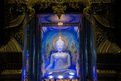Blue Buddha statue inside Temple Wat Rong Suea Ten in Thailand. Buddha statue inside Blue Temple Wat Rong Suea Ten in Chiang Rai, Thailand. Sacred relic of Thai stock images
