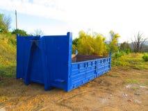 Blue builders skip Stock Image