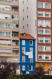 Blue building. Between two tall buildings Royalty Free Stock Images