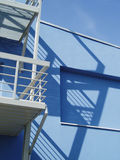 Blue building 2. Blue building against the blue sky Royalty Free Stock Photography