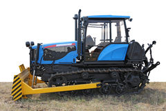 Blue building bulldozer tractor on grass Stock Images