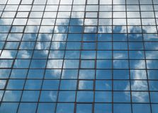 Blue building and clouds Royalty Free Stock Images