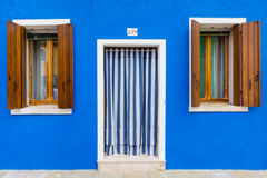 Blue building facade in Burano, Italy Royalty Free Stock Photos