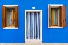 Blue building facade in Burano, Italy Royalty Free Stock Photos