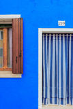 Blue building facade in Burano, Italy Stock Photo