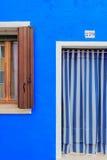 Blue building facade in Burano, Italy Stock Photo