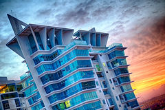 Blue building with golden hour light. Blue building with golden hour sunlight in Panama City Stock Images
