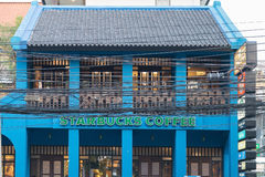 Blue building of Starbucks coffee Royalty Free Stock Photography