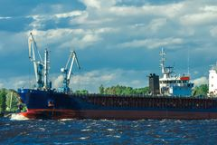 Blue bulk carrier. Moving in clear summer day stock photography