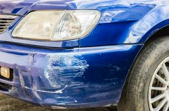 Blue bumper car scratched Royalty Free Stock Photography