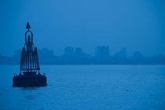 Blue buoy. Buoy on the water of the gulf between Cochin and Ernakukam i Kerala, India Royalty Free Stock Photo