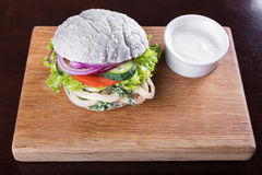Blue burger with sauce Royalty Free Stock Photography