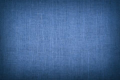 Blue burlap jute canvas background with shade. Natural blue burlap jute sackcloth bagging canvas texture pattern background with dark shade border royalty free stock image