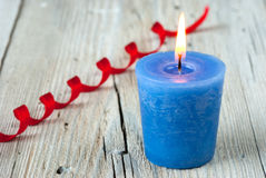 Blue burning candle Royalty Free Stock Images
