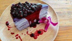 Blue bury crape cake on wood plate Stock Photos