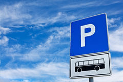 Blue bus parking sign against blue sky Royalty Free Stock Images