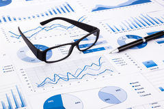 Blue business charts, graphs, document and paperwork Royalty Free Stock Photo