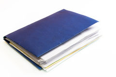 Blue Business Folder full of Papers. Folder full of business papers: bills, accounts receivable,invoices,receipts,etc. Blue folder with a business paperwork and Stock Images