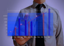 Blue business graph showing growth close up. Analyzing Royalty Free Stock Image