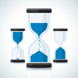Blue business styled sand clock icons. Blue flat business styled sand clock icons Royalty Free Stock Photos