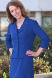 Blue business suit 4. Professional business woman standing outside her office Royalty Free Stock Photography