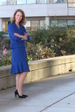Blue business suit. Professional business woman standing outside her office Royalty Free Stock Photography