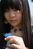 Girl holding blue butterfly on her hand Stock Photo