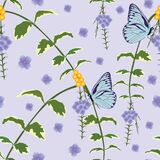 blue butterfly and purple flower and green leaves in the tropical garden