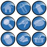 Blue Button Icons. Set of nine icon buttons depicting various commands. Circular buttons are blue with white images with black edging stock illustration