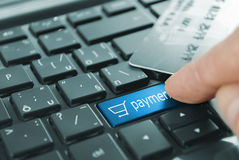 Blue button payment. Blue payment cart button or key on black keyboard stock image