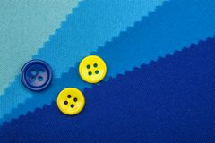 Blue button and samples of fabric texture detail Royalty Free Stock Image