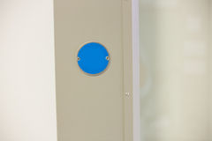 Blue button on the wall Stock Image