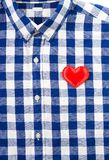 Blue buttoned checkered shirt with red felt heart, love or speci. Al gift concept background Stock Photography