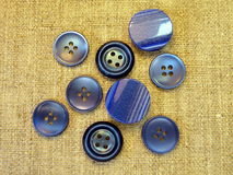 Blue buttons. On linen fabric Royalty Free Stock Photography